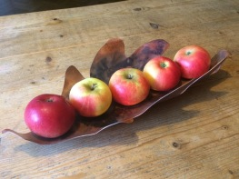 copper leaf containing apples